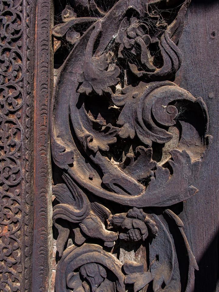 Fine woodwork at Min Kyaung Monastery, Kin village, Myanmar