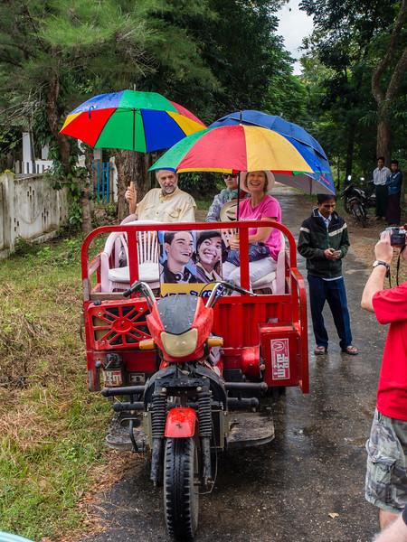 Our caravan through Mowlike village in the rain