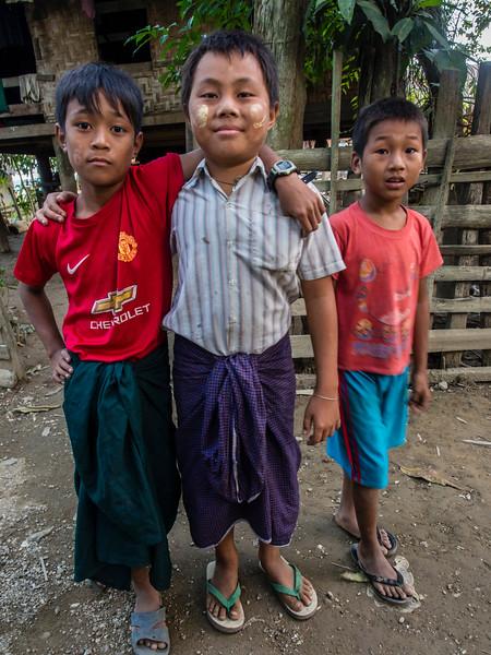 Boys posing for the camera in Youwa village, Burma