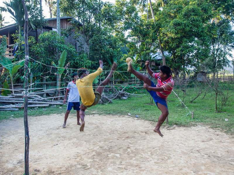 Boys playing net game in Youwa village