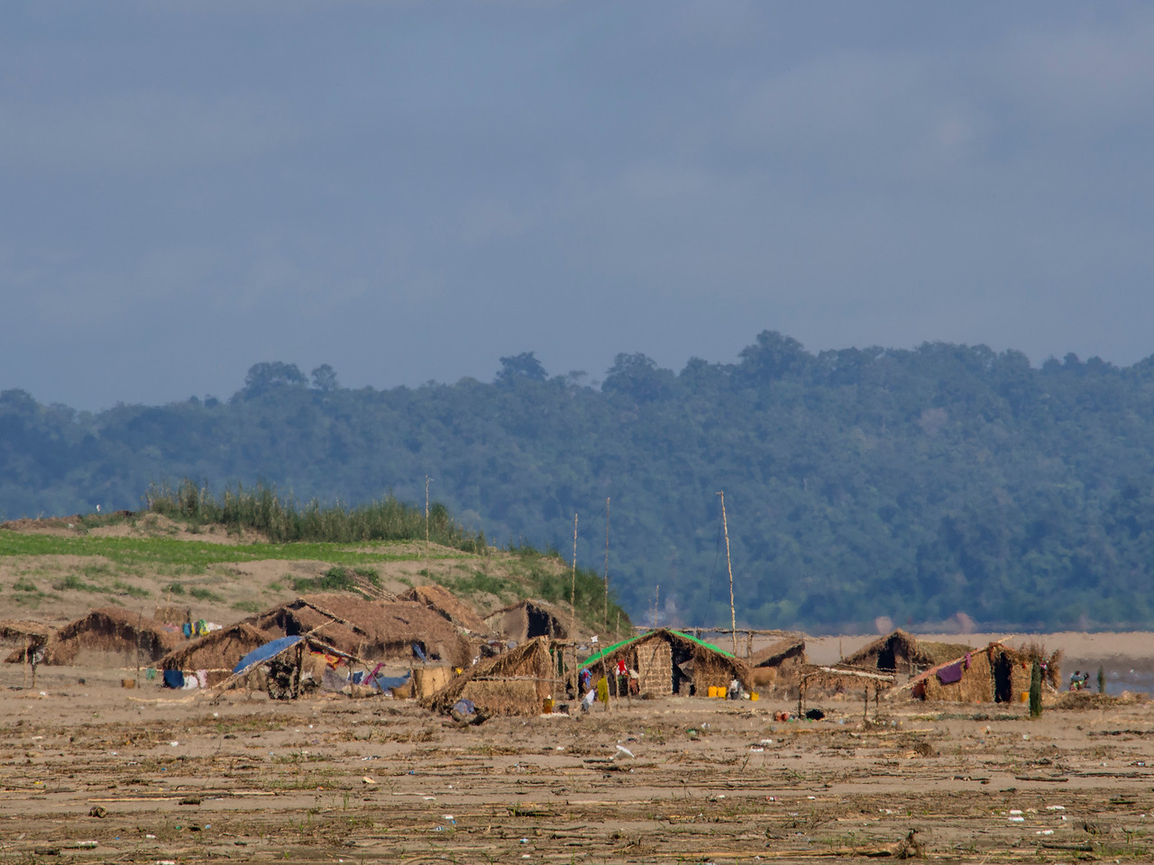 Group of thatch homes on Chindwin River sandbar