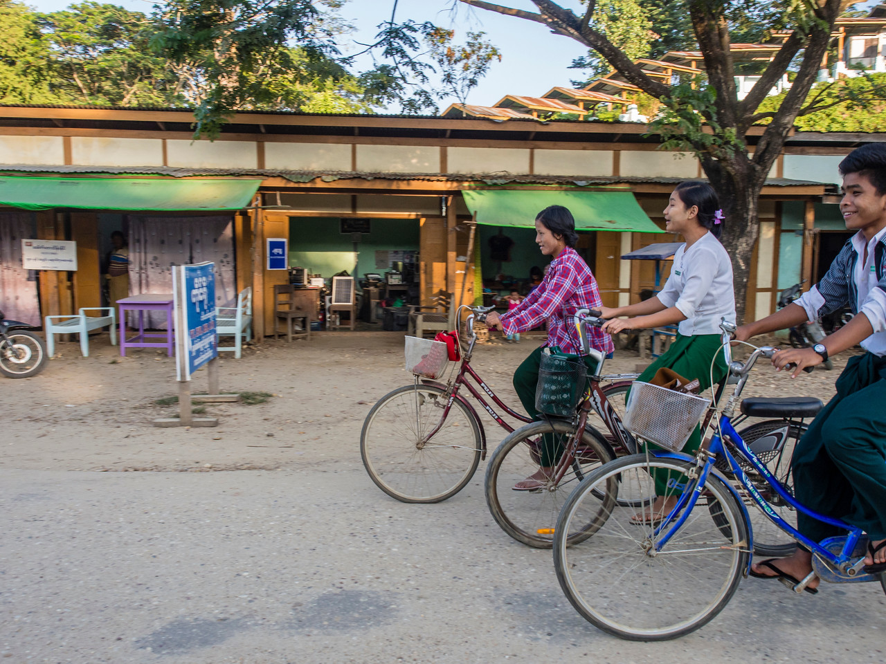Schoolkids riding home from school, Paung Pyin village