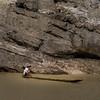 Man on cutout canoe on the Chindwin River