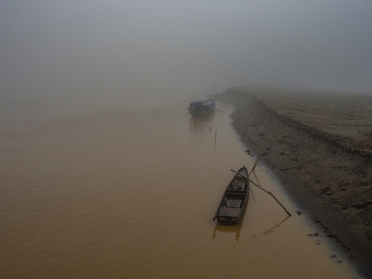 Boats in the morning mist on the Chindwin River