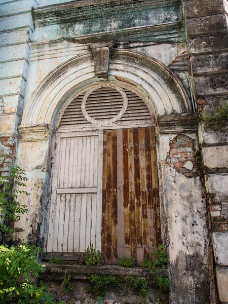 Old door in stone and brick building