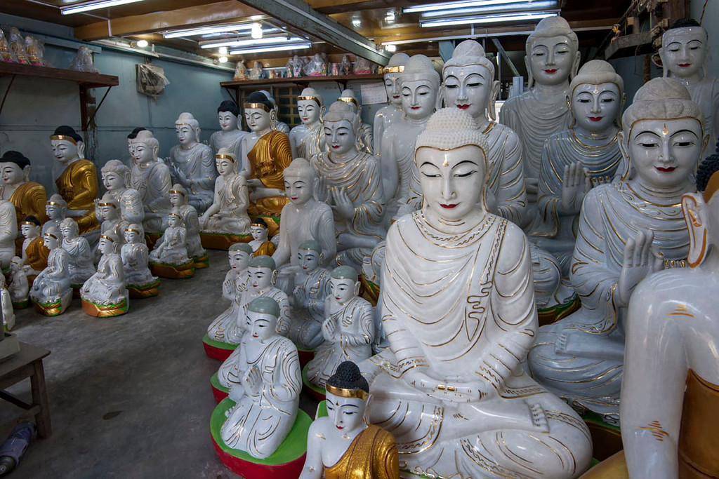A shop displays a selection of beautifully crafted statues.