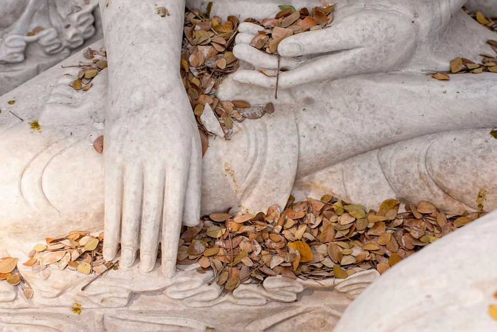 "Finely sculpted hands depict the ""Calling the Earth To Witness the Truth"" mudra."