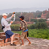 Shep jokes with the young postcard vendor during our sunrise shoot in Bagan.