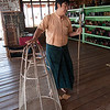 MM demonstrates the fishing nets used on Inle Lake.