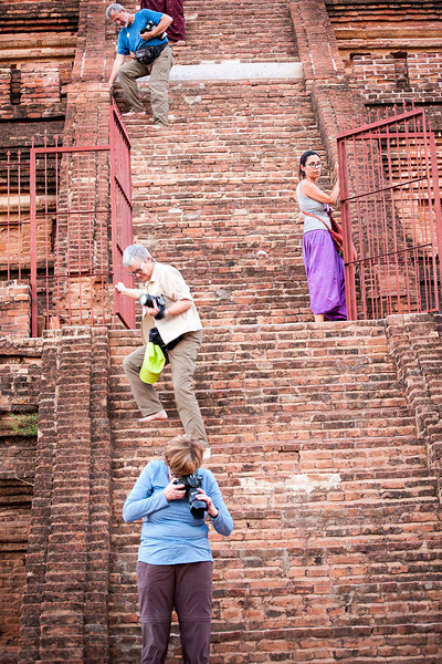 Gary, Ann and Judy make a careful descent from a very steep pagoda.
