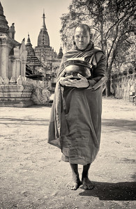 Monk Collecting Alms in front of Ananda Temple in Bagan.