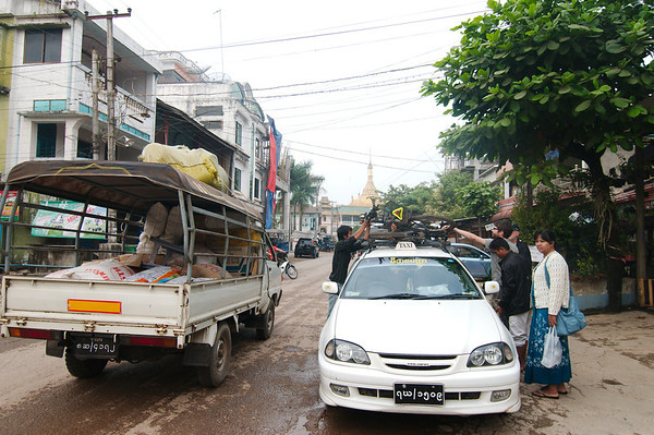 Loading the bikes on our taxi for the journey over the mountains to Thailand