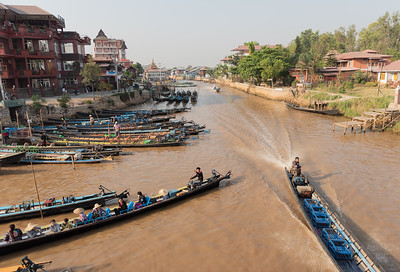 A boat heads back to the moorings after being out on Inle Lake, Myanmar