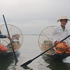 """It was a bit of a disappointment to learn that the photos we'd seen for so many years of traditional Inle Lake fishermen were actually staged. These guys charge a few dollars for their """"show"""" which we appreciated nonetheless"""