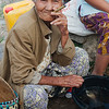 Cheroot smoking fish seller at the Nampan market