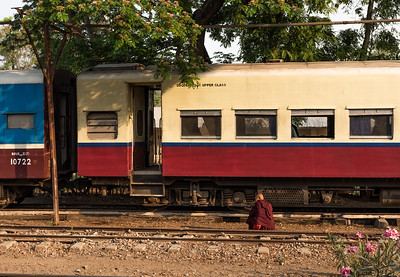 A Monk sits on the tracks while waiting for his train to depart, Kalaw, Myanmar
