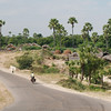 Riding past a typical village on the Mandalay-Bagan road