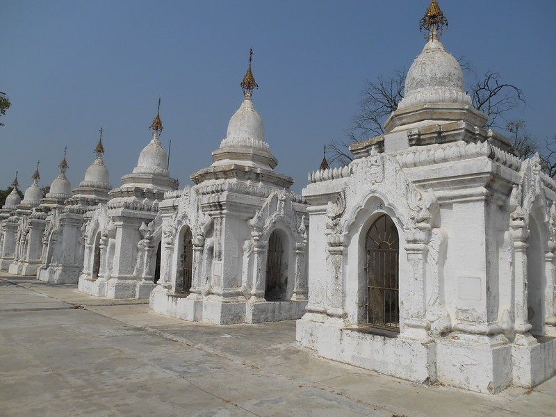 Kuthodaw Pagoda, built in 1857, is north of the palace at the base of Mandalay Hill.  Each of these 729 structures has a tablet with part of the Tipitaka (the original Buddhist scripture) carved on it.