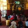 Women can observe the Mahamuni Buddha from afar