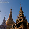 Smaller spires in the foreground appear to eclipse the massive 99 meters tall (325 feet) gold-plated 2,500 year old Shwedagon Pagoda in Yangon, Myanmar