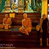 Three Buddhist monks at the Shwedagon Pagoda - Yangon, Myanmar