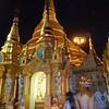 Shwedagon Pagoda at night - there is a dizzying assortment a Buddhist carvings, statues, and secondary buildings surrounding the Pagoda, with thousands of pilgrims and tourists (mostly Burmese), and monks circling