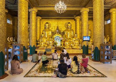 Golden Buddhas at Shwedagon Pagoda. Yangon.