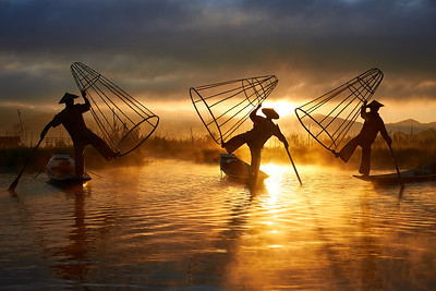 Three fisherman at sunrise