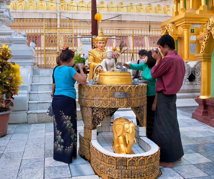 Worshiping at Shwedagon Pagoda. Yangon.