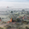 Early morning fog over the ancient city of Bagan, Myanmar; culture; history