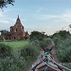 Horse-drawn cart heading towards Thabeik Hmauk temple, Bagan, Myanmar<br /> <br /> This temple is another popular spot to watch the sunset from.