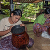 Women etching designs into vases at lacquer ware workshop, near Bagan, Myanmar