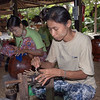 Woman weaving a pot from bamboo strips.  The pot will eventually be turned into lacquer ware, Bagan, Mayanmar