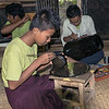 Boy etching designs into lacquer ware, , near Bagan, Myanmar