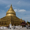 Shwezigon Pagoda, Hyuang Oo, Myanmar<br /> <br /> Shwezigon Pagoda is one of the oldest of ancient Bagan.  It was completed in by King Kyanzittha in 1089 to house a tooth relic  and hairs of the Buddha. It is the most important reliquary shrine (meaning built to house a Buddha relic) in the Bagan area. Pilgrims from throughout Burma travel here each year in the Burmese month of Nadaw (November-December) to celebrate. This festival includes both elements of pre-Buddhist Nat worship (Nats are pagan anamistic spirits) and Buddhist themes. Shwezigon is thus a center of pilgrimage for both the archaic shamanic culture of Burma and the newer religion of Buddhism.