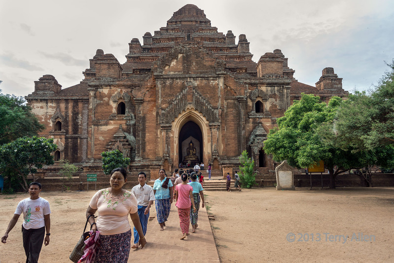 Steady stream of worshippers visiting the Dhammayangi Temple, Bagan, Myanmar