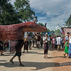 'Charging' paper mache rhino at street festival, Bagan, Myanmar<br /> <br /> The 'rhino' is casting a long shadow that adds interest to this otherwise empty corner of the photo.