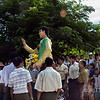 Villagers carrying paper mache statue of Aung San Suu Kyi at street festival, Bagan, Myanmar<br /> <br /> During our time in Myanmar it was obvious how popular and loved Aung San Suu Kyi was.