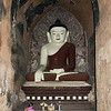Lone woman praying to Buddha, Dhammayangi <br /> Temple, Bagan, Myanmar