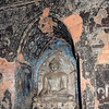 Small buddhe statue in a niche with frescos, inside a Bagan temple, Myanmar<br /> <br /> The photos inside the temples in this, and posts to come, were taken in almost total darkness using flash.  Looks better at larger sizes.
