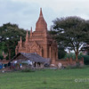 """Temple in their backyard, Bagan, Myanmar<br /> <br /> Second post today since these are the last of the images from Bagan; next comes Mandalay.  We took a late day ride by horse cart to see another area with temples and I was surprised to see this dwelling made with rattan mats and thatch right up against the wall of one of the temples.  Since many of you commented on the street food shot yesterday, if you look closely you can see a woman squatting at the left cooking over an outdoor fire.<br /> <br /> Update in response to comments: Farmers cannot own their land in Myanmar, and this is only a very minor temple of the thousands in the area and none of the others had dwellings like this, so its purpose will remain a mystery. My best guess is land inherited over generations, but in Burma there are no deeds for inherited land, so no possibility of offiicial ownership.<br /> <br /> The rest of the Bagan shots can be seen here: <a href=""""http://goo.gl/Y4hQxB"""">http://goo.gl/Y4hQxB</a>"""