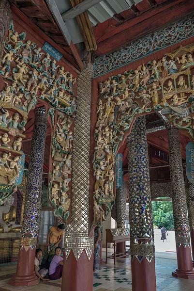 Local women sitting in ornate temple, Shwezigon Pagoda, Nyaung Oo, Myanmar