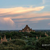 Dhammayangyi Temple at sunset, surrounded by stupas, Bagan, Myanmar (the temple itself is best seen at larger sizes)<br /> <br /> This is most massive temple in Bagan, with the best brick work.  It was built by King Narathu (1167-70), who, by all accounts, was pretty psycotic.  According to legend, Narathu oversaw the construction of the temple himself.  The bricks were laid without mortar, and the masons were executed if a needle could be pushed between the bricks they had laid. Narathu never completed the construction because he was assassinated before its completion, so there is no top section to the temple.