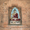 Statue of Buddha sitting on lotus blossom located in a wall niche, Pyathada Pagoda,, Bagan, Myanmar