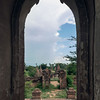 Ruined gate and stupas, seen from the doorway of a temple, Bagan, Myanmar