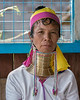 "Long neck Padaung woman, Inle Lake, Myanmar<br /> <br /> The Padaung tribe, also called Kayan Lahwi, are a subgroup of the ethnic Karen people.  <br /> <br /> Girls first start to wear brass rings, as a form of cultural identity, when they are around five years old, gradually adding more turns as they get older. The weight of the brass pushes the collar bone down and compresses the rib cage. According to Wikipedia, the neck itself is not lengthened; the appearance of a stretched neck is created by the deformation of the collar bone. The coils are rarely removed and the neck muscles under the coil become weakened.  In recent times, due to discouragement by the government of ring wearing, some women have been removing their coils.<br /> <br /> Portraits of older and younger women, with more, and with fewer, rings can be seen here, and also a couple of photos of a long neck woman weaving using a backstrap loom:  <a href=""http://goo.gl/8r1RDL"">http://goo.gl/8r1RDL</a><br /> <br /> 21/04/14  <a href=""http://www.allenfotowild.com"">http://www.allenfotowild.com</a>"