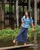 Girl leg-rowing a dugout canoe, Inle Lake, Myanmar<br /> <br /> Normally women don't leg row, but I saw this girl who seemed to be pretty good at it.