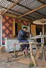 Man using foot pumped lathe to make umbrella handles, near He Ho, Shan Province, Myanmar