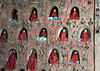 Small red-robed Buddhas in wall niches, Shwe Yaunghwe Kyaung Monastery, Nyaungshwe, Myanmar