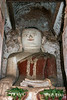 "Buddha statue inside an ancient overgrown stupa, Inn Thein, Inle Lake, Myanmar<br /> <br /> Inside many of the old stupas there remained some Buddha statues, with evidence that they were still being worshipped.  In this case, there were fresh flowers in front of the statue.<br /> <br /> Other photos of the old overgrown stupas can be seen here, including an interesting photo where the Buddha is partly covered by sand: <a href=""http://goo.gl/tc4Caf"">http://goo.gl/tc4Caf</a><br /> <br /> 26/04/14  <a href=""http://www.allenfotowild.com"">http://www.allenfotowild.com</a>"